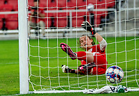 WASHINGTON, DC - SEPTEMBER 6: Virginia goalkeeper Holden Brown (99) is beaten on a penalty kick for a Maryland goal during a game between University of Virginia and University of Maryland at Audi Field on September 6, 2021 in Washington, DC.