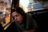 Ceci looks tired as she takes a taxi to school after working as a tango dancer at a restaurant in the El Caminito area of Buenos Aires.