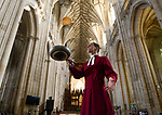 Canon Andy Trenier practising his pancake flipping at Winchester Cathedral