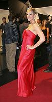 Mahée Paiement portait une robe rouge signée Le Château à la 10e Soirée des Jutra. La robe de Mahée arrivera en magasins le 11 mars (crédit: Sylvain Légaré) (Groupe CNW/Le Chateau Inc)