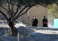 FAO JANET TOMLINSON, DAILY MAIL PICTURE DESK<br /> Pictured: Police officers conducting a search at the back of the house where Ben Needham disappeared from in Kos, Greece. Monday 03 October 2016<br /> Re: Police teams led by South Yorkshire Police, searching for missing toddler Ben Needham on the Greek island of Kos have moved to a new area in the field they are searching.<br /> Ben, from Sheffield, was 21 months old when he disappeared on 24 July 1991 during a family holiday.<br /> Digging has begun at a new site after a fresh line of inquiry suggested he could have been crushed by a digger.