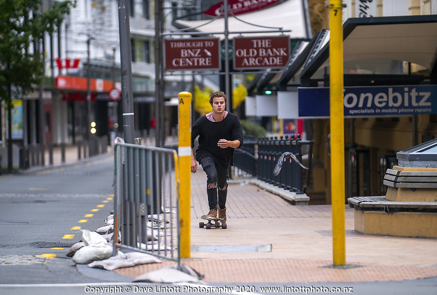 A lunchtime skateboarder on Lambton Quay. Wellington CBD during lockdown for the COVID19 pandemic in Wellington, New Zealand on Friday, 17 April 2020. Photo: Dave Lintott / lintottphoto.co.nz