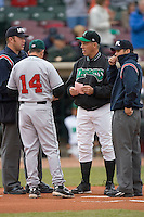 Dayton Dragons manager Todd Benzinger #25 exchanges line-up cards at home plate with Great Lakes Loons manager Juan Bustaba #14 at Fifth Third Field April 22, 2009 in Dayton, Ohio. (Photo by Brian Westerholt / Four Seam Images)