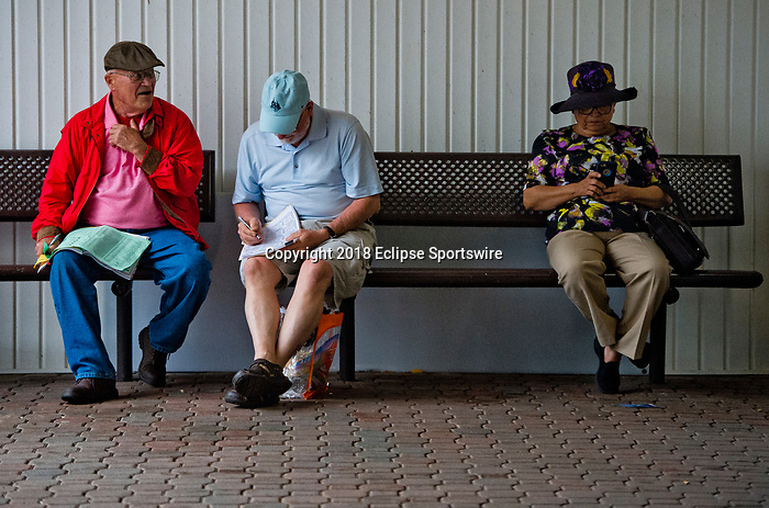 LOUISVILLE, KY - MAY 05: Men handicap a race on Kentucky Derby Day at Churchill Downs on May 5, 2018 in Louisville, Kentucky. (Photo by Scott Serio/Eclipse Sportswire/Getty Images)