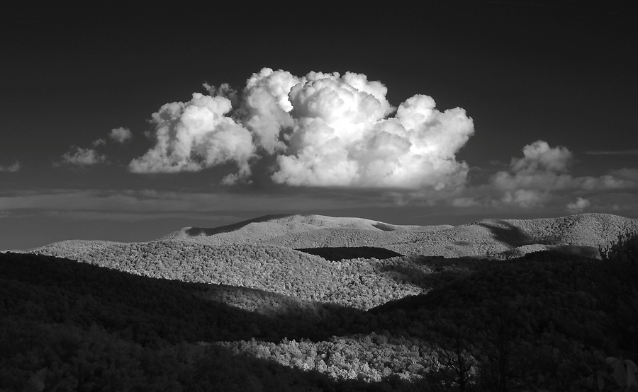 A single cloud floats just above the Blue Ridge Mountains in Nelson County, VA. Photo/Andrew Shurtleff