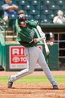 Trevor Brown (41) of the Augusta GreenJackets makes contact with the baseball against the Greensboro Grasshoppers at NewBridge Bank Park on August 11, 2013 in Greensboro, North Carolina.  The GreenJackets defeated the Grasshoppers 6-5 in game one of a double-header.  (Brian Westerholt/Four Seam Images)