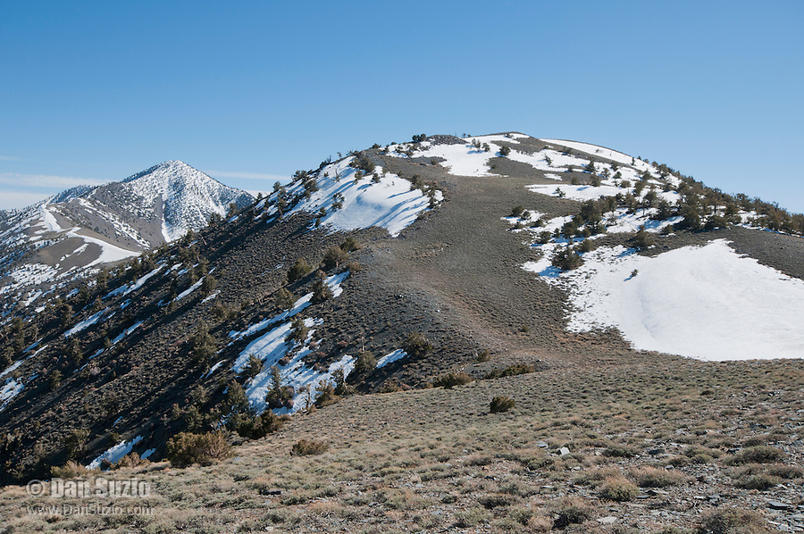 Telescope Peak, elevation 11,049 feet (left), and Bennett Peak, elevation 9,980 feet, in the Panamint Range on the Western edge of Death Valley. Death Valley National Park, California