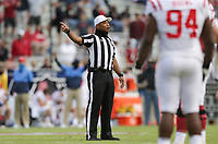 An official makes an announcement, Saturday, October 17, 2020 during the fourth quarter of a football game at Donald W. Reynolds Razorback Stadium in Fayetteville. Check out nwaonline.com/201018Daily/ for today's photo gallery. <br /> (NWA Democrat-Gazette/Charlie Kaijo)