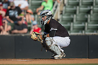Kannapolis Intimidators catcher Carlos Perez (23) warms up the pitcher between innings of the game against the Augusta GreenJackets at Intimidators Stadium on May 30, 2016 in Kannapolis, North Carolina.  The GreenJackets defeated the Intimidators 5-3.  (Brian Westerholt/Four Seam Images)