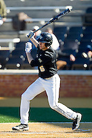 Evan Stephens (5) of the Wake Forest Demon Deacons lines a base hit to left field in the bottom of the 9th inning against the Youngstown State Penguins at Wake Forest Baseball Park on February 24, 2013 in Winston-Salem, North Carolina.  (Brian Westerholt/Four Seam Images)