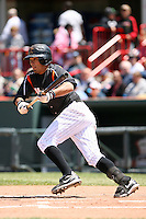 May 31, 2009:  First Baseman Max Leon of the Erie Seawolves lays down a bunt during a game at Jerry Uht Park in Erie, NY.  The Seawolves are the Eastern League Double-A affiliate of the Detroit Tigers.  Photo by:  Mike Janes/Four Seam Images