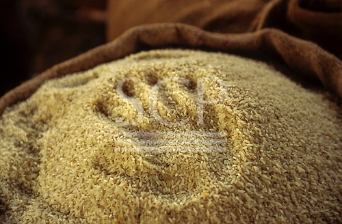 Kigoma, Tanzania; sack of rice with the impression of a hand. indentation. Aid give us a hand.