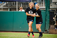 TACOMA, WA - JULY 31: Sofia Huerta #11 and Kristen McNabb #19 of the OL Reign enter the pitch for warm ups before a game between Racing Louisville FC and OL Reign at Cheney Stadium on July 31, 2021 in Tacoma, Washington.