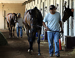 LOUISVILLE, KY -MAY 20: Ax Man (foreground), winner of the Sir Barton Stakes at Pimlico (Baltimore, Maryland) walks the shedrow ahead of his stablemate, Kentucky Derby and Preakness winner Justify, at Churchill Downs (Louisville, Kentucky) the day after their winning races in Maryland. (Photo by Mary M. Meek/Eclipse Sportswire/Getty Images)