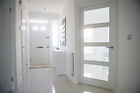 """COPY BY TOM BEDFORD<br /> Pictured: The hallway<br /> A home-loving mum is looking forward to a bright 2017 - everything she owns is white.  <br /> Claire Dix, 51, lives in white house where all the inside walls, floors and ceilings are white.<br /> Her furniture is white, her sheets and towels are white - even her Persian cat Mr Darcy is white.<br /> She drives a white Porsche sports car and the other family car is - you've guessed, it white.<br /> And to keep her home spotless she even has a white, limited-edition Dyson cleaner.<br /> Claire said: """"It's not an obsession, just a matter of style - I happen to like white."""