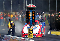 May 6, 2017; Commerce, GA, USA; An NHRA moves out of the way as funny car driver Robert Hight goes sideways as he does a burnout during qualifying for the Southern Nationals at Atlanta Dragway. Mandatory Credit: Mark J. Rebilas-USA TODAY Sports