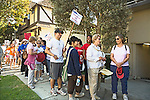 Men,women of all ages walk with signs to bring attention to mental illness in Santa Monica, California in the Fall
