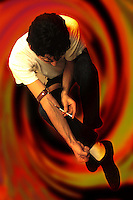 Disagio sociale.Social disease.Uomo mentre fa uso di eroina. Man while using heroin......