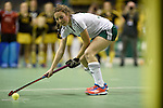 Berlin, Germany, January 31: Teresa Martin Pelegrina #13 of HTC Uhlenhorst Muehlheim tries to score a penalty during the 1. Bundesliga Damen Hallensaison 2014/15 semi-final hockey match between HTC Uhlenhorst Muehlheim (white/green) and Harvestehuder THC (black/yellow) on January 31, 2015 at the Final Four tournament at Max-Schmeling-Halle in Berlin, Germany. Final score 6-5 after penalties (3-1, 3-3, 3-3, 3-3). (Photo by Dirk Markgraf / www.265-images.com) *** Local caption ***