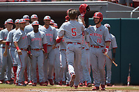 Patrick Bailey (5) of the North Carolina State Wolfpack is greeted at home plate by teammate Evan Edwards (18) after hitting a home run against the Northeastern Huskies at Doak Field at Dail Park on June 2, 2018 in Raleigh, North Carolina. The Wolfpack defeated the Huskies 9-2. (Brian Westerholt/Four Seam Images)