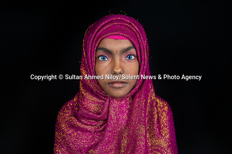 Pictured: Tasnim<br /> <br /> Family members with an unusual pigmentation show off their shockingly bright, blue eyes.  Eyes of this colour are rare for people of a darker skin tone, and the cause is a lack of melanin pigment in the iris of the eye.<br /> <br /> Lower levels of melanin are more commonly found in people with lighter skin tones, meaning they are more likely to have lighter coloured eyes.  The grandfather's name is Shukur Mia, who is photographed with his granddaughter Tasnim, 11, and grandson Mehedi, 6.  SEE OUR COPY FOR DETAILS.<br /> <br /> Please byline: Sultan Ahmed Niloy/Solent News<br /> <br /> © Sultan Ahmed Niloy/Solent News & Photo Agency<br /> UK +44 (0) 2380 458800