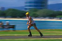 A skater at Magic Island, Ala Moana Beach Park, in Honolulu