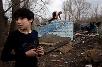 Children play in a crumbled house in the town of Tver, between Moscow and St Petersburg.
