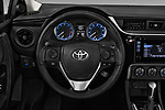 Car pictures of steering wheel view of a 2018 Toyota Corolla L 4 Door Sedan