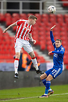 9th January 2021; Bet365 Stadium, Stoke, Staffordshire, England; English FA Cup Football, Carabao Cup, Stoke City versus Leicester City; James McClean of Stoke City keeps the ball in play with a header as Timothy Castagne of Leicester City appeals