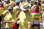 WALKERS GATHER TO LISTEN TO SPEAKERS AT BEGINNING OF CANCER WALK