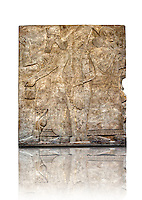 Assyrian relief sculpture panel  of a female protective spirits  from Nimrud, Iraq.  865-860 B.C North West Palace.  British Museum Assyrian  Archaeological exhibit.