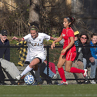 Boston College forward/midfielder Kate McCarthy (21) on the edge as Marist College defender Jessica Arabia (6) defends. Boston College defeated Marist College, 6-1, in NCAA tournament play at Newton Campus Field, November 13, 2011.