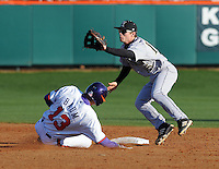 Jay Baum (13) of the Clemson Tigers steals second base with Alec Paradowski (15) of the Wofford Terriers defending in the fifth inning of a game on Wednesday, March 6, 2013, at Doug Kingsmore Stadium in Clemson, South Carolina. Clemson won, 9-2. (Tom Priddy/Four Seam Images)