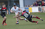 Ulster replacement Sam Arnold steps inside Dragons replacement Ashton Hewitt.<br /> Guinness Pro12<br /> Gwent Dragons v Ulster<br /> 08.03.15<br /> ©Steve Pope - SPORTINGWALES