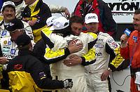 Ron Fellows receives a hug from long-time teammate Chris Kneifel in Victory Lane..39th Rolex 24 at Daytona, 3/4 February,2001 Daytona International Speedway  Daytona Beach,Florida,USA.©F.Peirce Williams 2001 ..