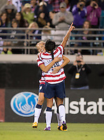 Sydney Leroux (14) of the USWNT celebrates her goal with teammate Kristie Mewis (23) during the game at EverBank Field in Jacksonville, Florida.  The USWNT defeated Scotland, 4-1.