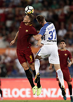 Calcio, Serie A: Roma, stadio Olimpico, 26 agosto, 2017.<br /> Roma's Edin Dzeko (l) in action with Inter's Milan Skriniar (r) during the Italian Serie A football match between Roma and Inter at Rome's Olympic stadium, August 26, 2017.<br /> UPDATE IMAGES PRESS/Isabella Bonotto