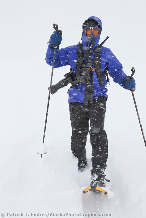 Snowshoeing on the ruth glacier in a snowstorm, Alaska Range mountains, Interior, Alaska.
