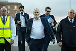 © Joel Goodman - 07973 332324 . 25/09/2016 . Liverpool , UK . Labour leader JEREMY CORBYN accompanied by advisors and security guards , walking outside by the docks in Liverpool , at the end of the first day of the Labour Party Conference . Photo credit : Joel Goodman