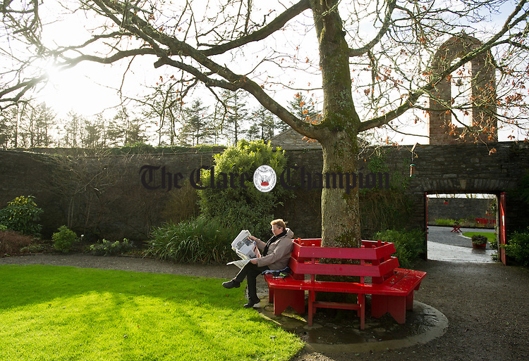 Gardener Gemma Hennessy relaxes in the Spring Sunshine  with the 'Champion during her lunch break in the Vandeleur Walled gardens in Kilrush. Photograph by John Kelly.