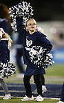 Olivia Keller, 6, cheers with Nevada Cheerleader's Perform with the Pack youth program before the start of an NCAA college football game between Nevada and San Jose State, in Reno, Nev., on Saturday, Nov. 16, 2013. (AP Photo/Cathleen Allison)