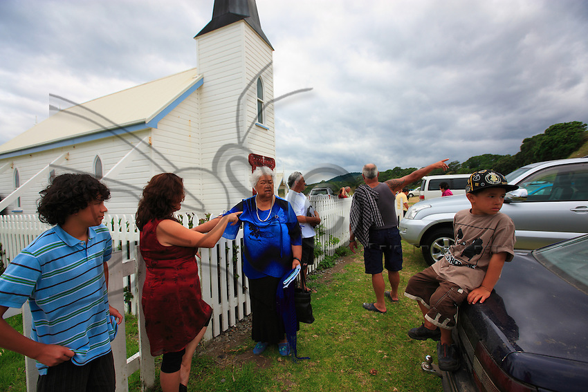 After the service, in front of the Anglican church of Raukokore, a Maori family.
