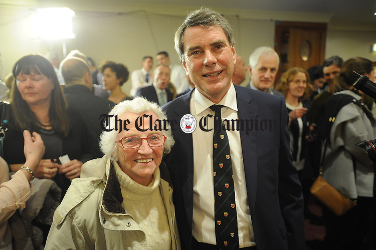 Dr Michael Harty, Independent, chatting with supporter Maureen Cotter at theGE2016 count in Ennistymon. Photograph by John Kelly.