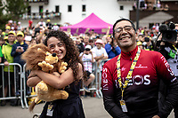 Happy girlfiend and father of Egan Bernal (COL/Ineos) seeing how he becomes the new GC leaderand is being celebrated on the podium.<br /> <br /> Stage 19: Saint-Jean-de-Maurienne to Tignes (126km)<br /> 106th Tour de France 2019 (2.UWT)<br /> <br /> ©kramon
