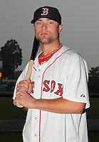 Lowell Spinners outfielder Bryce Brentz (14) poses for a photo in a Boston Red Sox uniform during a rain delay at Falcon Park in Auburn, New York August 9, 2010.  Brentz was selected in the 2010 MLB Draft by the Red Sox in the 1st (supplemental) round (36th overall) out of Middle Tennessee State.  The game between the Lowell Spinners and Auburn Doubledays was cancelled due to rain.  Photo By Mike Janes/Four Seam Images