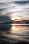 Sunset over the Wachusett Reservoir in Clinton, Massachusetts, vertical