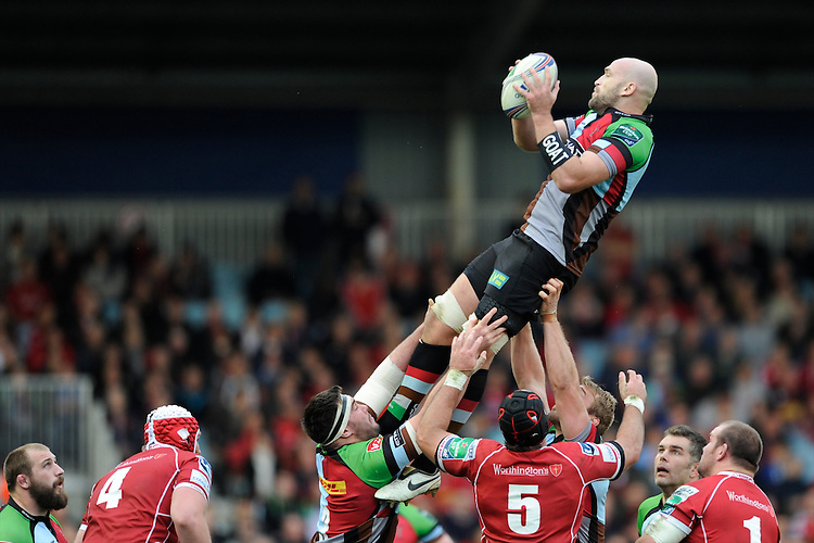 George Robson of Harlequins secures the lineout ball during the Heineken Cup Round 1 match between Harlequins and Scarlets at the Twickenham Stoop on Saturday 12th October 2013 (Photo by Rob Munro)