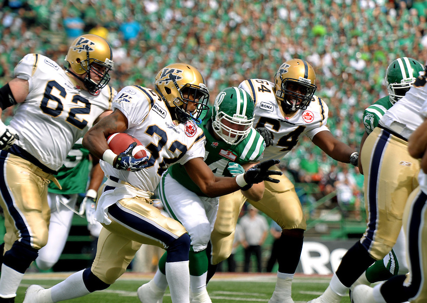 Winnipeg Blue Bombers running back Fred Reid runs the ball during the Labour Day Classic in Regina Sunday, September 5, 2010. THE CANADIAN PRESS/Mark Taylor.