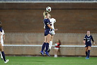 CHAPEL HILL, NC - NOVEMBER 29: Taylor Otto #6 of the University of North Carolina heads the ball over Jalen Woodward #15 of the University of Southern California during a game between University of Southern California and University of North Carolina at UNC Soccer and Lacrosse Stadium on November 29, 2019 in Chapel Hill, North Carolina.