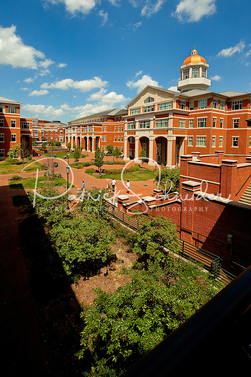 Photography of Charlotte NC's University of North Carolina at Charlotte campus (UNC Charlotte). UNCC, a public university located in northeast Charlotte, is part of the University of North Carolina higher education system. Opened in 1946, the campus has experienced explosive growth in recent years, including the addition of its Charlotte Research Institute campus and a football team. Photo shows the College of Health and Human Services Building.